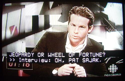 Ryan Reynolds on Newsworld program. Caption: JEOPARDY OR WHEEL OF FORTUNE? >> Interview: OH, PAT SAJAK