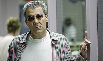 Ken Finkleman in tiny round sunglasses