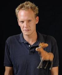 Jonathan Torrens with a moose on his polo shirt