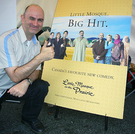 Me giving thumbs-up by 'Little Mosque' poster