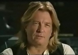 Bob Rock, with long strawberry-blond hair