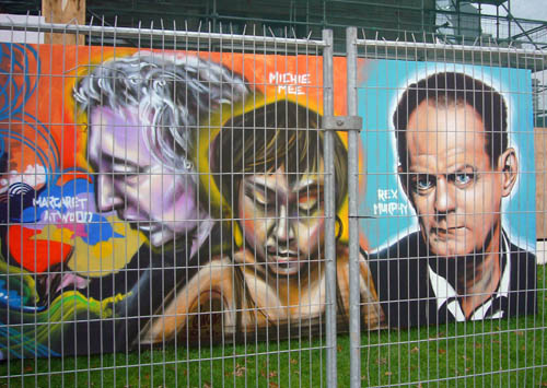 Graffiti-style mural of Margaret Atwood, Michie Mee, and Rex Murphy