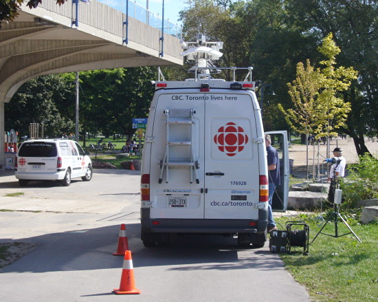 Microwave truck and van. Legend: CBC. Toronto lives here