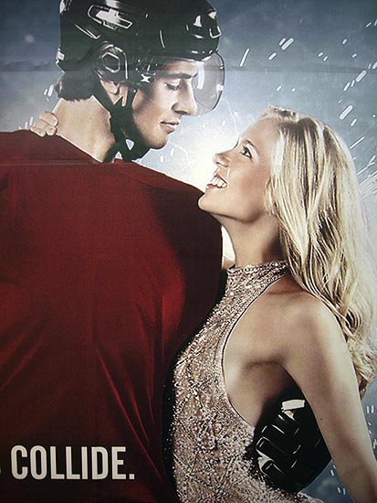 Young male hockey player in plain red jersey stares into the eyes of female figure skater in a sequinned gown