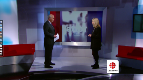 Peter Mansbridge and Kim Fox stand about six feet from each other