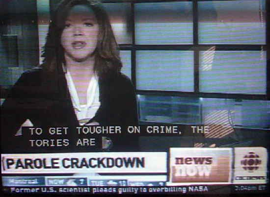 Carole MacNeil with onscreen graphics