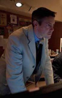 David Michael Lamb in shirt, tie, white jacket